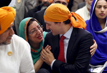 Canada's PM Trudeau talks to a woman during a Vaisakhi celebration on Parliament Hill in Ottawa