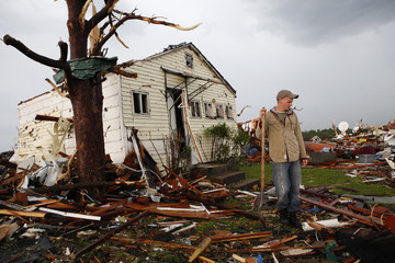 Ryan Harper pauses while looking for a missing friend after a devastating tornado hit Joplin, Missouri
