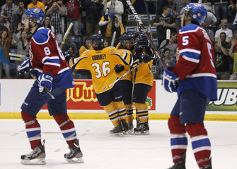 Shawinigan Cataractes' players celebrate after Michael Bournival scored a goal against the Edmonton Oil Kings during the second period of their tie breaker Memorial Cup ice hockey game in Shawinigan
