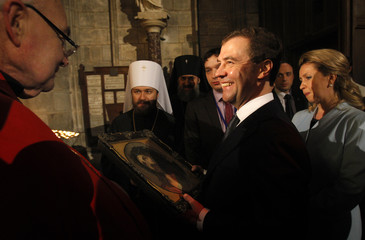 Russia's President Medvedev and his wife Svetlana visit the Notre Dame Cathedral in Paris