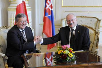 Slovakia's President Gasparovic and his Polish counterpart Komorowski pose for photo at the presidential palace in Bratislava