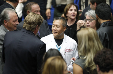 """Rhee is greeted during the """"Together We Thrive: Tucson and America"""" event  in Tucson"""