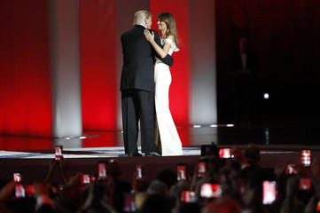"""U.S. President Donald Trump and his wife, first lady Melania Trump, dance their first dance as first couple to the song """"My Way"""" at his """"Liberty"""" Inaugural Ball in Washington"""