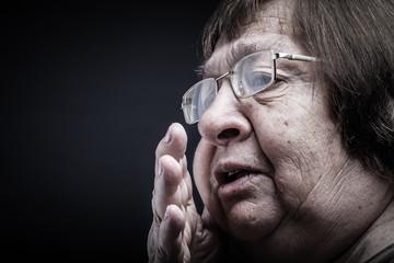 Portrait of elderly woman. Secret. Toned