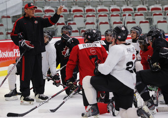 Team Canada head coach Don Hay explains drills to the red team during practice at the Canadian national junior hockey team selection camp in Calgary