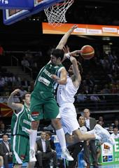 Ozbolt of Slovenia tries to block Fernandez of Spain during their FIBA EuroBasket 2011 quarter final basketball game in Kaunas