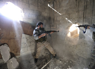 Free Syrian Army fighters fire back at Syrian army during heavy fighting in Mleha suburb of Damascus