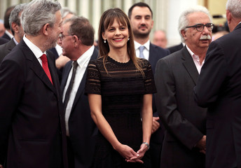 Newly appointed Labour Minister Effie Achtsioglou smiles during a swearing-in ceremony of the newly appointed members of the government at the Presidential Palace in Athens