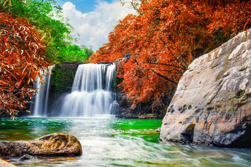 Waterfall in autumn forest and  bule sky,Klong Chao Waterfall in Koh Kood island,Trat Thailand