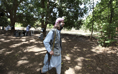 American born Islamist militant fighter Omar Hamami walks after addressing a news conference at a farm in southern Mogadishu?s Afgoye district