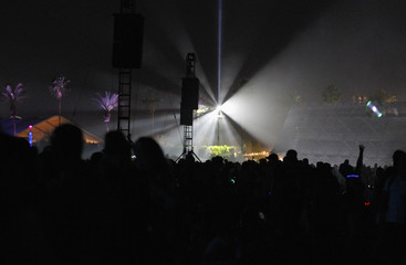 Spotlights shine out over the crowd during the 2nd day of the Coachella Valley Music & Arts Festival in Indio