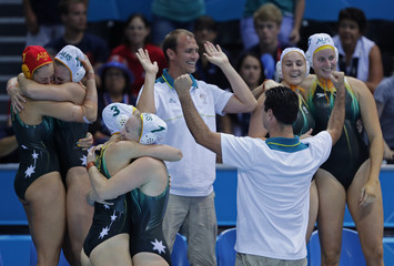 Australia's team reacts after they defeated Hungary in their Women's Bronze Medal water polo match during the London 2012 Olympic Games