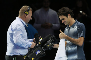 Federer of Switzerland reacts after winning his men's singles tennis match against Gasquet of France at the ATP World Tour Finals at the O2 Arena in London