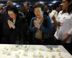 Japanese women living in Brazil pray during a ceremony to honour victims of Japan's earthquake and tsunami, in Sao Paulo