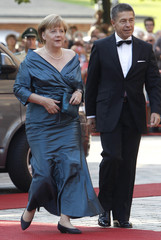 German Chancellor Merkel and her husband Sauer arrive for opening of Bayreuth Wagner opera festival in Bayreuth