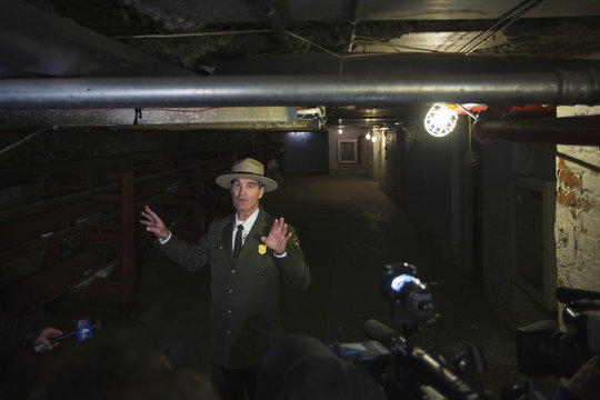 Superintendent of the Statue of Liberty and Ellis Island National Parks Luchsinger speaks to reporters about how high the water flooded the basement of the Ellis Island immigration museum building in New York