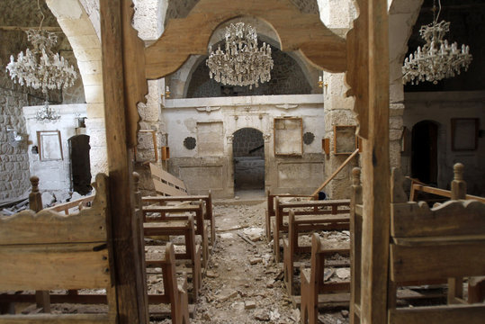 Debris lie inside a damaged church in Mar Bacchus Sarkis monastery, in Maloula village, northeast of Damascus