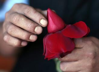 Florist Trinidad Rojas prepares roses for Valentine's Day in Los Angeles