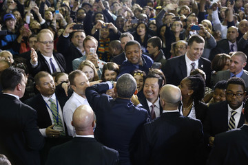U.S. President Obama greets people after remarks on raising the minimum wage in New Britain