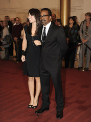 Comedian Meadows poses for photographers with his date Flanders on the red carpet as they arrive at the Kennedy Center in Washington