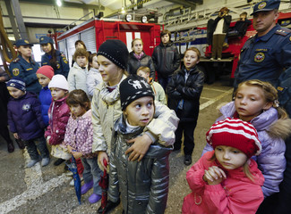 Children who fled the fighting in the eastern regions of Ukraine, attend an excursion to a fire station in Krasnoyarsk