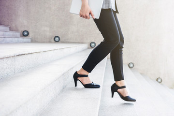 Business working woman steps walking at outdoor stair, side view, Lifestyle and Motivation of modern female concept