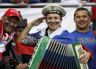 Fans of Russia cheer before the start of their Group A Euro 2012 soccer match against Czech Republic in Wroclaw