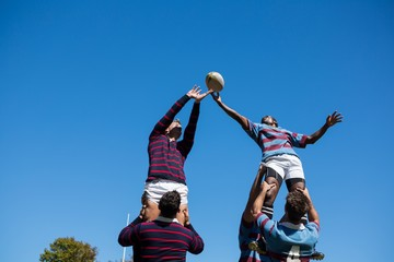 Low angle view of teams playing rugby