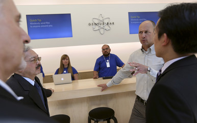 Apple Inc.'s Bridger talks with San Francisco city officials at the Genius Bar at Apple's flagship retail store in San Francisco