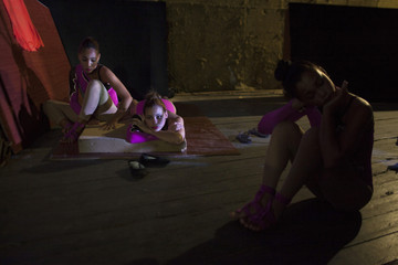 Actresses relax moments before performing in the Cuban National Circus show in Havana