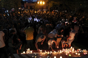 Hundreds of people light candles in tribute to the victims of Friday's Paris attacks, in Santo Domingo