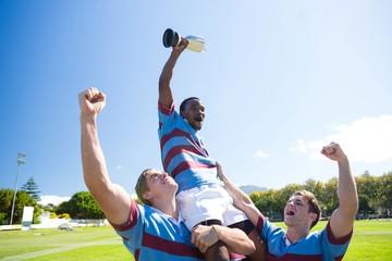 Happy rugby team enjoying victory