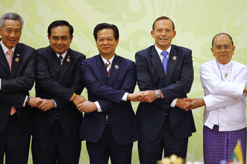Dignitaries hold hands before the ASEAN-Australia 40th Anniversary Commemorative Summit during the 25th ASEAN Summit at the Myanmar International Convention Centre in Naypyitaw