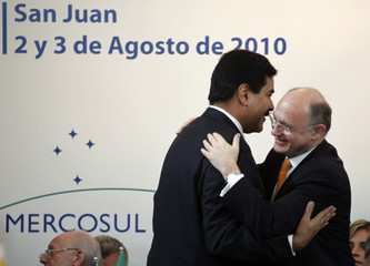 Argentina's Foreign Minister Timmerman embraces his Venezuelan counterpart Maduro during the 39th Mercosur summit in San Juan