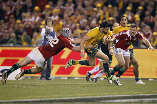 Australia Wallabies' Adam Ashley-Cooper heads for the line to score a try during their rugby union test match against the British and Irish Lions in Melbourne