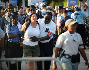 Police officers detain a woman after she failed to obey orders, near the site of the Democratic National Convention in Philadelphi