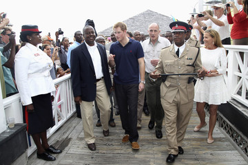 Britain's Prince Harry is cheered by crowds of people during a visit to Harbour Island in Nassau, Bahamas