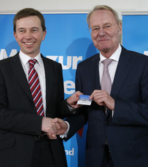 Lucke leader of  Alternative for Germany party hands over party membership card to Henkel Euro-sceptic and former head of BDI in Berlin