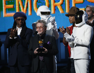 """Producer Paul Williams accepts the award for Album of the year for Daft Punk's """"Random Access Memories"""" as Rodgers and Pharrell Williams applaud at the 56th annual Grammy Awards in Los Angele"""