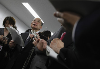 TEPCO recently selected incoming chairman Shimokobe is surrounded by the media after a meeting with bailout body officials in Tokyo