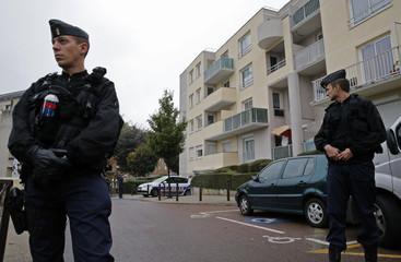 French gendarmes secure a garage entrance in Torcy near Paris