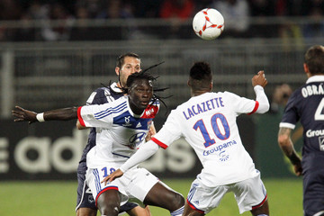 Olympique Lyon's Gomis challenges Marange of Girondins Bordeaux during their French Ligue 1 soccer match at the Gerland stadium