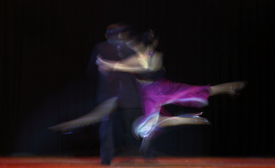 Hebe Lucia Hernandez and Nahuel Tortosa dance during the final round of the Tango World Championship in Stage style in Buenos Aires