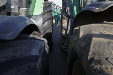 A French Farmer walks amongst tractors as he demonstrates in Strasbourg
