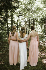bride and bridesmaids from behind