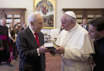 Pope Francis greets Israeli President Peres during a private meeting at the Vatican