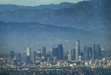 File photo of the city of Los Angeles, California is pictured on a hot summer day next to the San Gabriel mountains