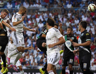 Real Madrid's Benzema heads the ball to score a goal against Cordoba during their Spanish first division soccer match in Madrid