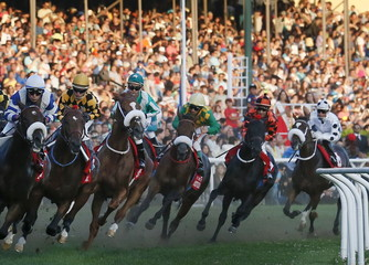 """Jockey Hernan Eduardo Ulloa on """"Rio Allipen"""" makes a turn on his way to winning the 131st running of the Derby horse race at Sporting Club in Vina del Mar city, Chile."""