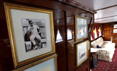Pictures are seen on the wall in the salon of the former presidential yacht, Honey Fitz, as it is docked in West Palm Beach